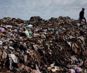A boy walks through a pile of garbage and human waste in Old Fadama slum, Accra, Ghana, October 24, 2010.