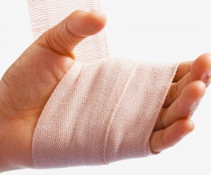 hand-being-bandaged-as-injury_Mk0BjVvO-min