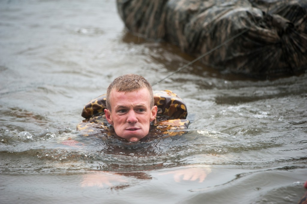 The Wisconsin Army National Guard's 1st Lt. Nicholas Plocar tows a poncho raft filled with military gear as part of a demanding water obstacle April 14, during the 2013 Best Ranger Competition at Fort Benning, Ga. (MCoE photo by Patrick Albright)