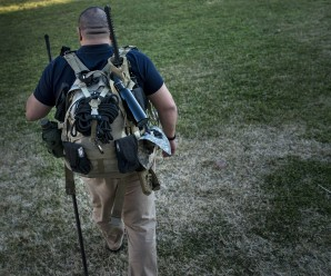 Jay Blevins walks to his backyard with a bug out bag, a quick grab bag with about 40 pounds of survival gear including a Katana sword, December 5, 2012 in Berryville, Virginia. Jay Blevins and his wife Holly Blevins have been preparing with a group of others for a possible doomsday scenario where the group will have to be self sufficient due to catastrophe or civil unrest. AFP PHOTO/Brendan SMIALOWSKI