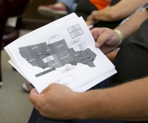 A man holds a map of the Jade Helm 15 military exercise at a public hearing about the Jade Helm 15 military training exercise at the Bastrop County Commissioners Court in Bastrop on Monday April 27, 2015.  An overflow crowd came to the meeting to hear a presentation and ask questions of  Lt. Col. Mark Lasatoria, of the U.S. Army Special Operations Command, about the controversial military exercise that will take place in several states this summer.   JAY JANNER / AMERICAN-STATESMAN